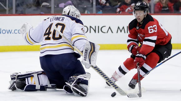 Buffalo Sabres goaltender Robin Lehner (40), of Sweden, defends his net as New Jersey Devils left wing Jesper Bratt (63), of Sweden, attacks during the second period of an NHL hockey game, Friday, Dec. 29, 2017, in Newark, N.J. (AP Photo/Julio Cortez)