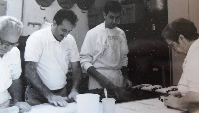 The Scuderis — from left, Joseph; his son, Nuccio; his grandson, Joe; and his wife, Fernanda — work at the bakery in this circa 1995 photo.