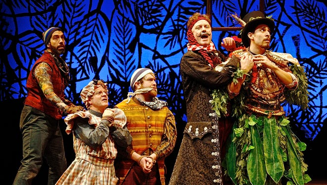 Black Stache (Tom Story, second from right) threatens Fighting Prawn, the leader of the Mollusks (Arturo Soria, right) as Smee (José Restrepo, left), Mrs. Bumbrake (Andy Paterson, second from left) and Alf (Nick Vannoy, center) look on, in the Cincinnati Playhouse in the Park's production of Peter and the Starcatcher by Rick Elice.