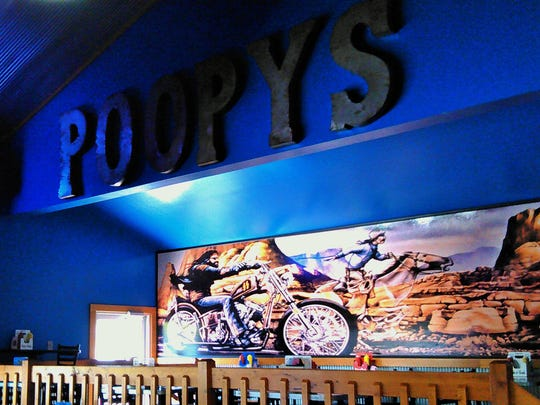 Motorcycle murals are part of the ambiance at Poopy's