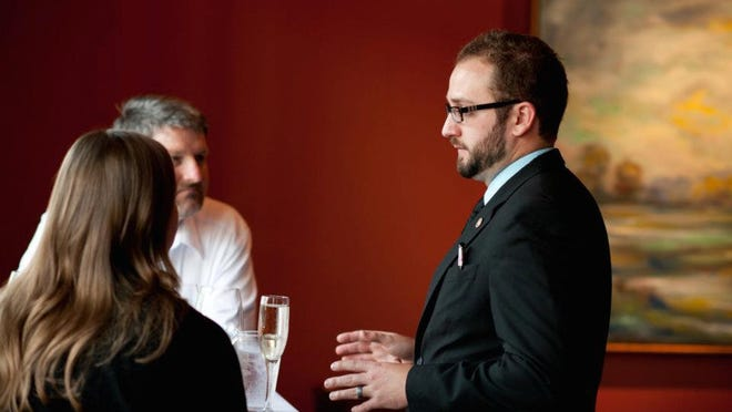 Ben Leger, founder of MySomm, speaks to customers. MySomm offers professional wine selection and delivery services in Acadiana.