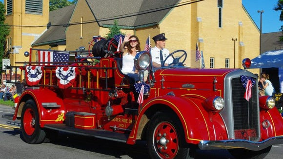 The annual Firemen's Parade gives districts a chance to show off all of their equipment, new and old, like this old Webster truck. (M. Rosenberry)