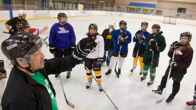 Youth hockey coach Bob Gutwein works with players during a girls' team practice this past spring at the Coral Ridge Ice Arena. Players are forming a new U14 girls' team this fall called the Eastern Iowa Lady Hawks.