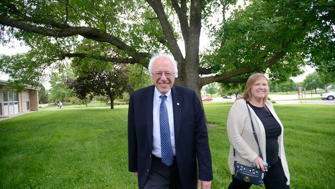 Bernie and Jane Sanders arrive at Muscatine Community College to speak with area Democrats and activists on May 29, 2015. A Republican official has raised allegations against Jane Sanders related to her time as president of Burlington College in Vermont.