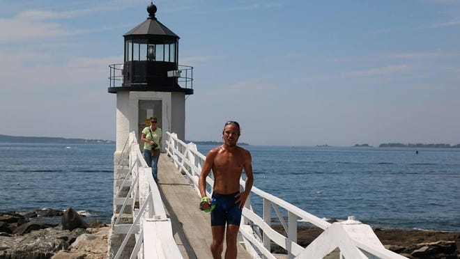 Run, Barclay, Run! Barclay Oudersluys finishes his 3,200-mile trek on the famed wooden walkway of the Marshall Point Lighthouse in Maine.