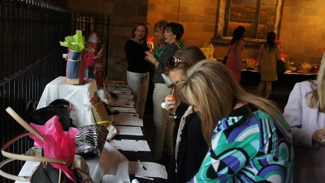 Proceeds from Handbag Happy Hour support the Springfield Public Schools' Academy of Exploration.