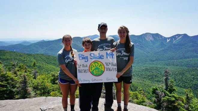 Catherine Ferreri, left, poses with her family last summer after hiking to the summit of Big Slide Mountain, completing all 46 of the Adirondack's high peaks. Years of hiking the peaks factored in on Ferreri's decision to study environmental science in college. To Ferreri's left is her brother Matthew; father Anthony; and sister Emily.