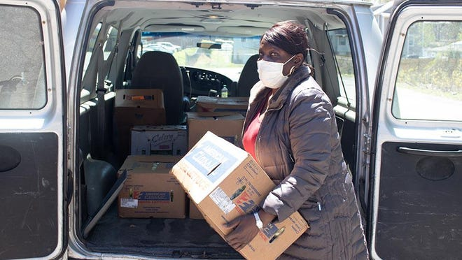 Hyacinth Hill unloads donations for the food pantry in Newburgh.