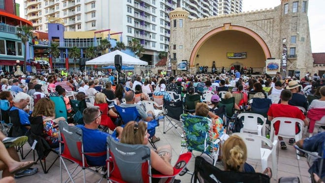 A tribute band plays at the Daytona Beach Bandshell as part of the Summer Concert Series. The normally packed crowds will be much smaller this year amid the coronavirus pandemic, with capacity limited to 27%. Rather than attendees bringing their own chairs, there will be chairs for pairs of two provided and spaced out in wider aisles to allow for social distancing. Face masks are required.