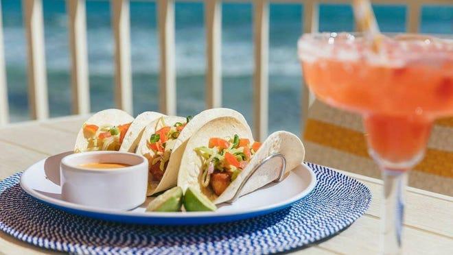 As part of Temple Orange's three-course lunch menu, entree selections include mahi mahi tacos.