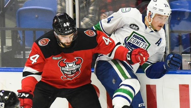 Reid Boucher, right, is coming off a third consecutive standout season with the Utica Comets. He led the team with a record 34 goals and 67 points.