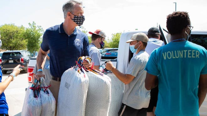 Lubbock Christian University President Scott McDowell helps students move on to campus Friday.