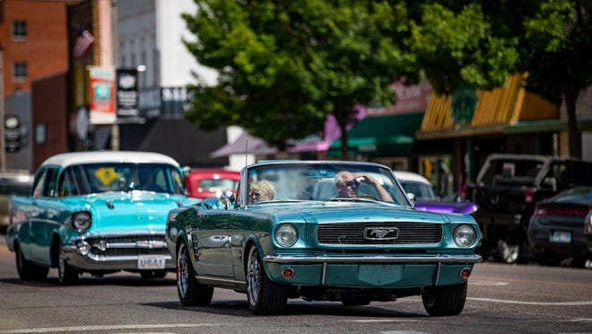 A pair of classic cars cruise through downtown Durant during the 2019 Draggin' Main Classic Car Show and Cruise. This year's event is scheduled for Oct. 2-3.
