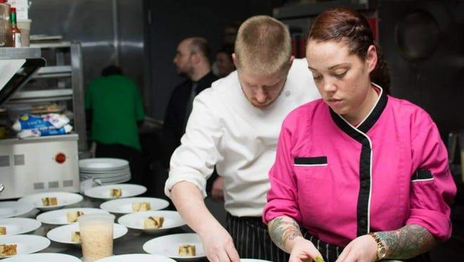 Chefs and restaurateurs Jordan and Aurora Coffey at work.