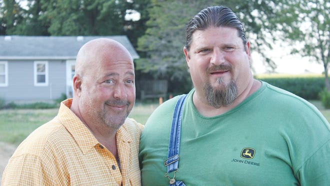 Andrew Zimmern of Bizarre Foods Delicious Destination and Bizarre Foods America tv shows and Carl Blake.