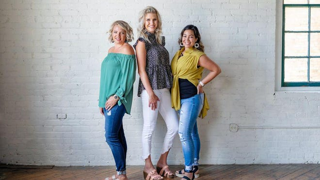 Representatives from The Poppy Peach pose for a photo. The store, celebrating its first anniversary, specializes in women's fashion, home decorations and gifts.