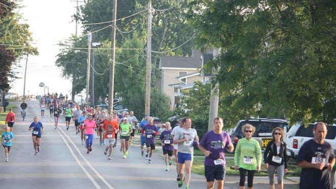 People are seen participating in the 2014 Firecracker 7K fundraiser. The 2020 run/walk takes place Saturday, July 4, in Manitou Beach.