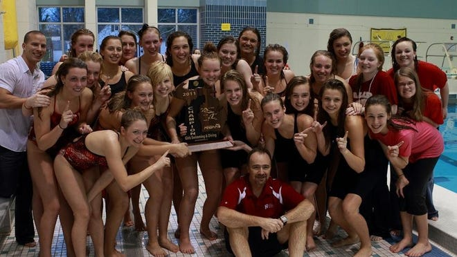 The Holland girls swim team after its historic state championship performance.