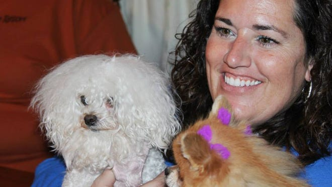 Jennifer Kluesner and her pet poodle mix, Monkey, are half the ownership team behind Jett and Monkey's Dog Shoppe in the East Village.