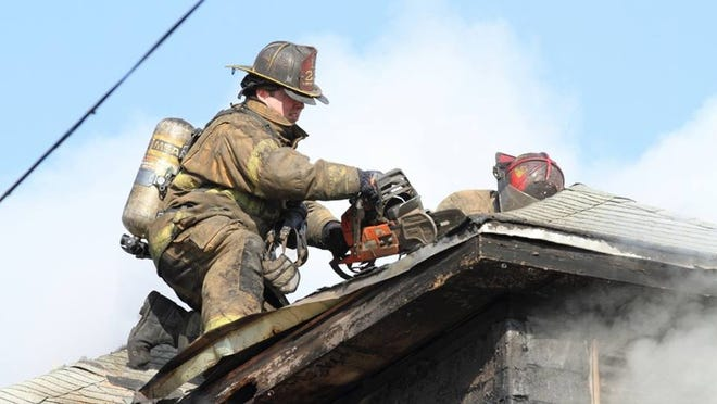 Detroit firefighters from Ladder Company 22 battle a blaze in Detroit. The firefighters are trying to raise funds after their chainsaw and K-14 saw were stolen Sunday morning.