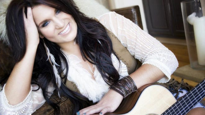 """Nashville singer Liz Moriondo grew up on a farm in Mt. Vernon and played basketball at Drury University for a year before transferring. Her Bass Pro Shops parody of """"All About That Bass"""" on YouTube had nearly 4,000 views by end of Tuesday."""