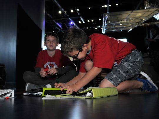 5th graders Ethan Pickett and Aiden Sperr from Apollo elementary in Titusville are participating in Space School at the Kennedy Space Center Visitor Complex.