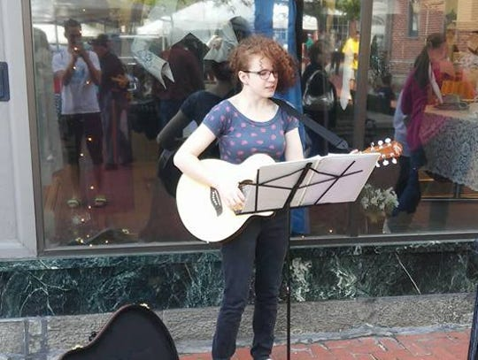 Eliza Schmidt busks on the streets of Gettysburg.