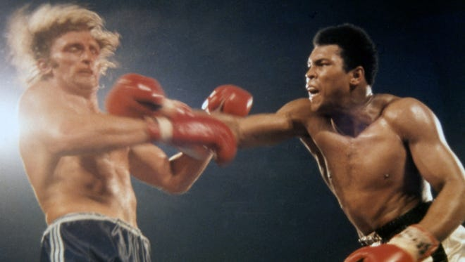 """American Heavyweight Champion Muhammed Ali, right, launches an attack on Joe Bugner, British and European Heavyweight Champion, during their 12 round Heavyweight fight in Los Vegas, Nevada, on Feb. 14, 1973. Ali is one of numerous celebrities whose deaths have been linked to sepsis (often reported as """"complications of"""" another illness), according to the Sepsis Alliance."""