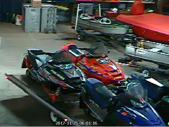 Milwaukee police say these snowmobiles and the trailer were stolen during a burglary on Nov. 25 in the 1200 block of W. Bruce St.