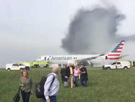 American Jet Blows Tire Catches Fire At O Hare 8 Injured