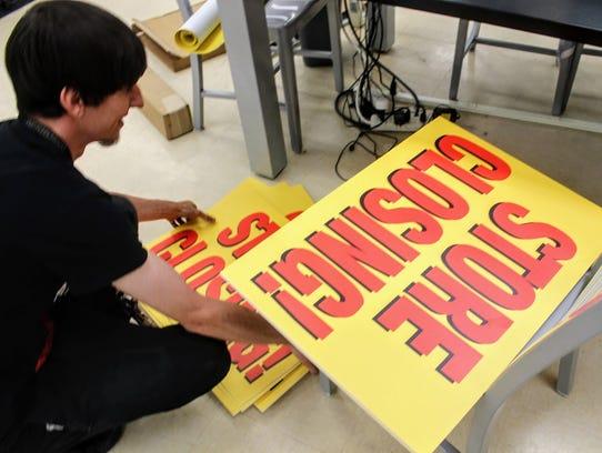 Alamogordo Sears employee Jericho Mckim prepares putting