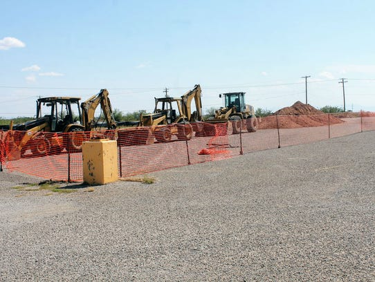 Construction crews set up their equipment at the Hobby