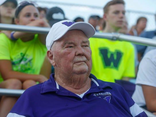 Gordy Emmons watches as the Waukee softball team knocks