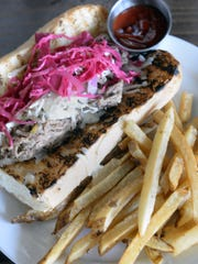 The Cochinita Poboy, is a slow roasted pulled pork