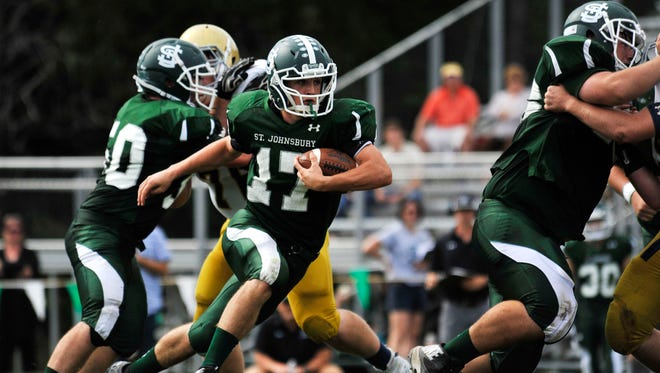 Collin Urie looks for yards Saturday during St. Johnsbury's 36-14 high school football win over Essex.