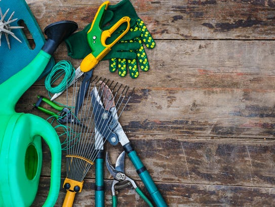garden tools on a wooden table. view from above