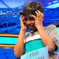 "Srinath Mahankali, 11, of New York, N.Y., stands onstage Thursday before correctly spelling ""sphenogram"" during the Scripps National Spelling Bee in Oxon Hill, Md."