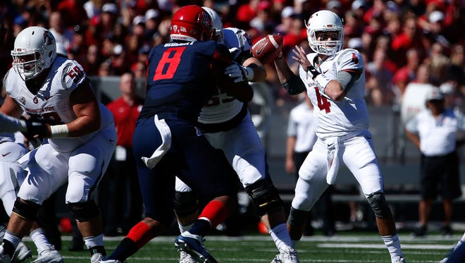 Washington State qarterback Luke Falk drops back to pass against the Arizona Wildcats at Arizona Stadium on Oct. 24, 2015 in Tucson.