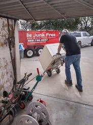 Mike Tyler, owner of Be Junk Free, removes unwanted