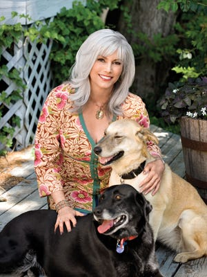 Emmylou Harris and two of her dogs.
