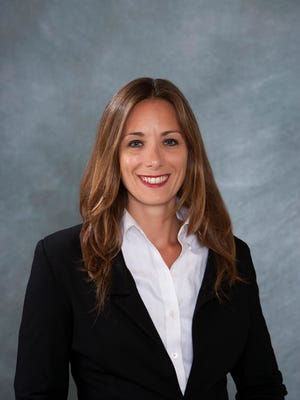 Karalyn Woulas is leading by eight votes in the Cocoa Beach City Commission Seat 3 race, prior to an expected recount.