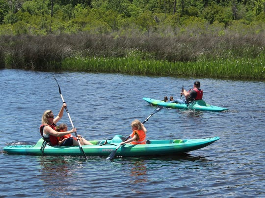 Family kayaking sometimes requires instruction to get everyone paddling in the same direction.