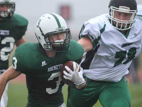 James Buchanan's Owen Stoner rushes with the football