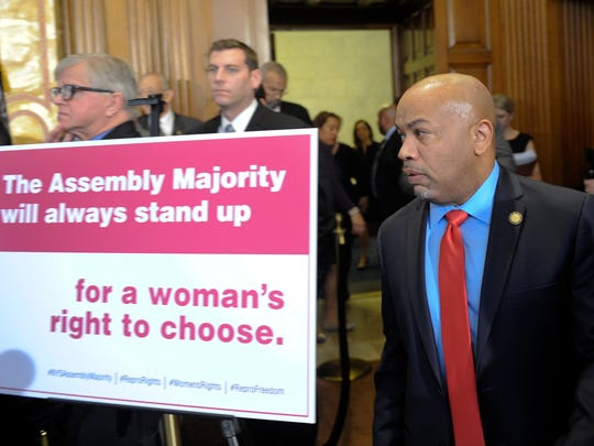 Assembly Speaker Carl Heastie, D-Bronx, arrives for a news conference announcing the state Assembly would pass legislation protecting women's reproductive health rights and affordable family planning, Tuesday, Jan. 17, 2017, at the Capitol in Albany, N.Y.
