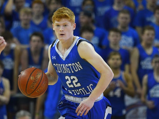 CovCath guard Aiden Ruthsatz dribbles up court against