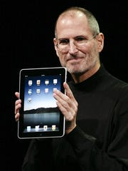 Apple CEO Steve Jobs unveils the iPad in 2010.