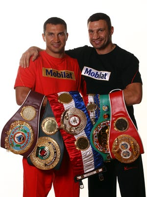 Brothers Wladimir, left, and Vitali Klitschko have held various heavyweight titles since 2000.