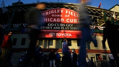 FILE - In this Oct. 18, 2017 file photo, fans arrive at Wrigley Field before Game 4 of baseball's National League Championship Series between the Chicago Cubs and the Los Angeles Dodgers in Chicago. Wrigley Field will still feel plenty familiar to Cubs fans this season even as the 104-year-old ballpark undergoes more major renovations. Cubs owner Tom Ricketts, optimistic about chasing the team's second World Series title in three seasons, visited his team's spring training home Monday, Feb. 19, 2018 for the first full-squad workout by the 2016 World Series champions on a cool day in the desert. (AP Photo/Nam Y. Huh)