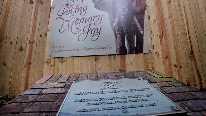 A fence now covers the view of where the African elephant exhibit once was at The Greenville Zoo on Thursday, July 10, 2014. Attached to the fence is a photo memorial of Joy, the elephant that passed away in transit to the Cheyenne Mountain Zoo.