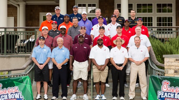 From left to right (top down): Paul Johnson, Jon Barry (Georgia Tech), Gus Malzahn, Bo Jackson (Auburn), Dabo Swinney, Steve Fuller (Clemson), Randy Edsall, Scott McBrien (Maryland), Urban Meyer, Jeff Long (Ohio State), Dave Doeren, Terry Harvey (N.C. State), Rich Rodriguez, Kenny Lofton (Arizona), Steve Spurrier, Sterling Sharpe (South Carolina),  Dan Mullen (Mississippi State), Tommy Tuberville, Kevin Huber (Cincinnati), Sean Tuohy (Ole Miss), Larry Fedora, Roy Williams (North Carolina), Fred McCrary (Mississippi State), Mark Ingram, Nick Saban (Alabama) and Hugh Freeze (Ole Miss) pose for their coaches photo during the 2015 Chick-fil-A Peach Bowl Challenge on the Oconee Golf Course at Reynolds Plantation on Tuesday, April 28, 2015. (Chick-fil-A Peach Bowl/Abell Images/Paul Abell)